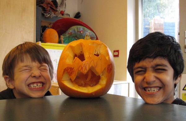 Halloween pumpkin caving and children