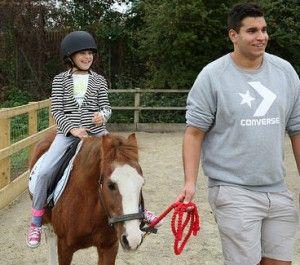 Pony rider and volunteer