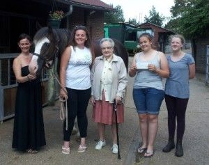Gladys presents cheque to farm