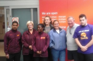 Sainsburys and farm staff