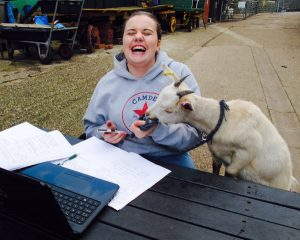 Goatkid & happy volunteer