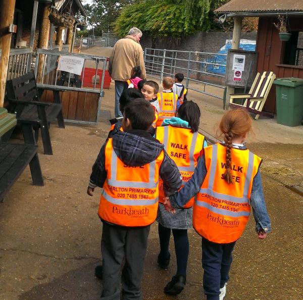 Schoolchildren tour the farm with Education Officer