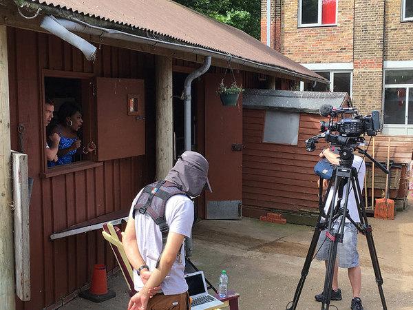 Children's TV crew filming on the farmyard