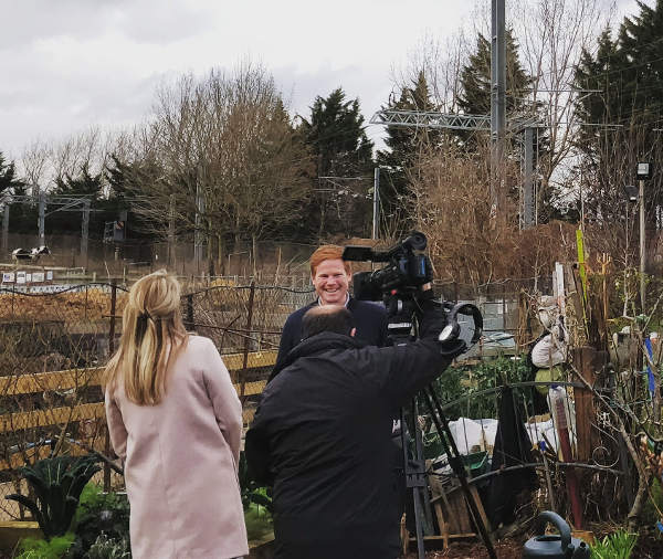 BBC World News crew filming from the Farm gardens