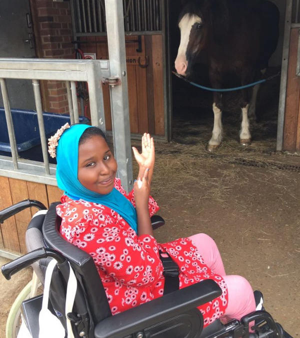 Educational visit by deaf student - meeting a horse