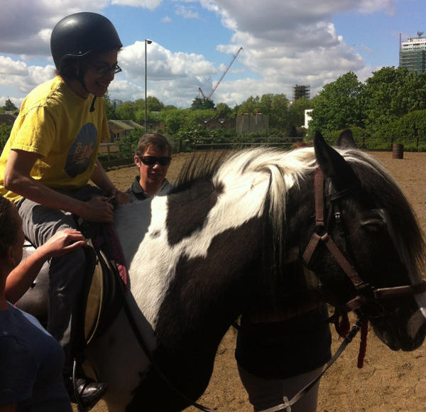Therapy riding session  for an adult with special needs