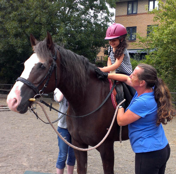 Weekend pony ride for young child
