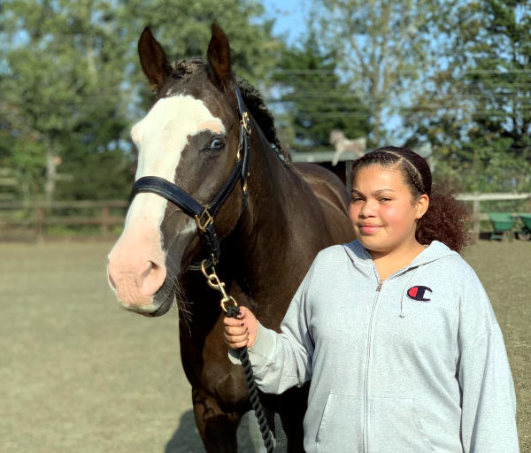 Pony Club rider with horse, Champion