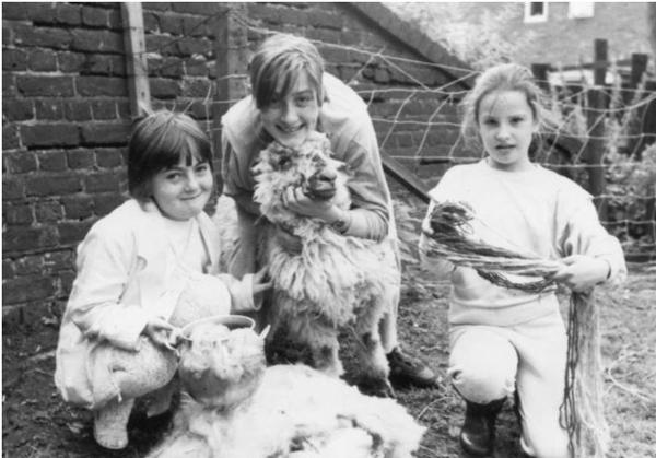 Children with a sheep show wool making stages