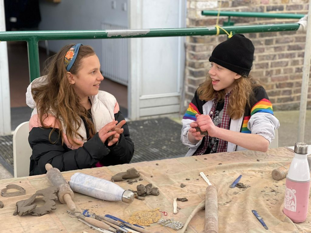 Two children in pottery together
