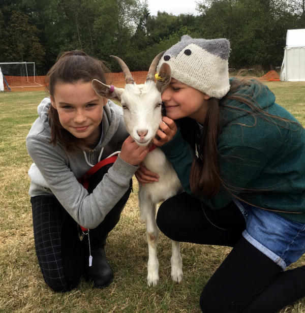 2 young farmers with prize winning goat kid