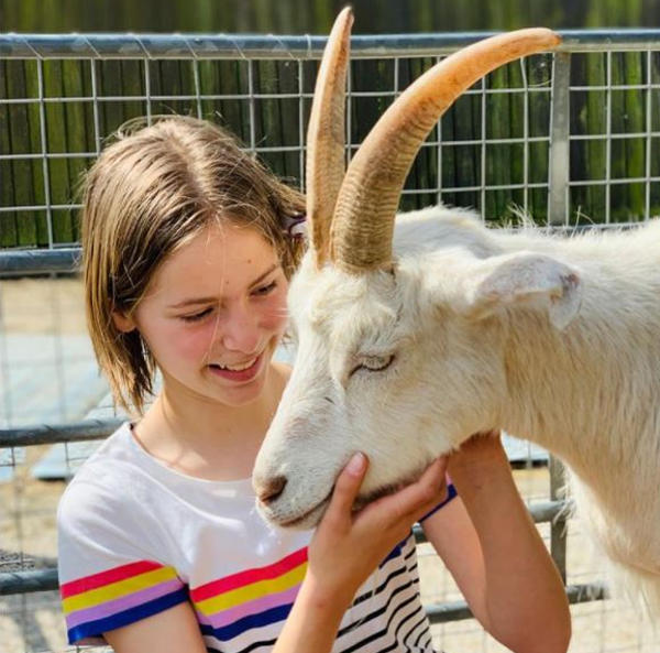 Young Farmer holding goat